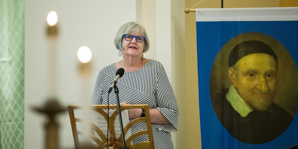 Mary Jo Shannon makes remarks at the beginning of the Centennial Mass on Jan. 26, 2020 at St. Benedict Parish--birthplce of SVdP in Washington State.