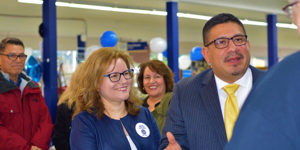 Burien Mayor Jimmy Matta, right,shown here with SVdP Exec. Dir. Mirya Munoz Roach, talking wwth employees at the Centennial Employee event at the Burien thrift store.