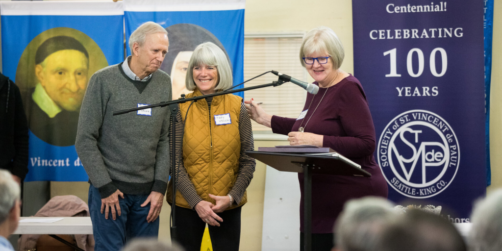 Mary Jo Shannon, (far right), shown here presenting a special recognition award to Pat & Mary Welch, (left), at the Centennial Council meeting for years of service to SVdP. Pat served on the Board and Finance Committee and Mary served on the Development Committee for many years.