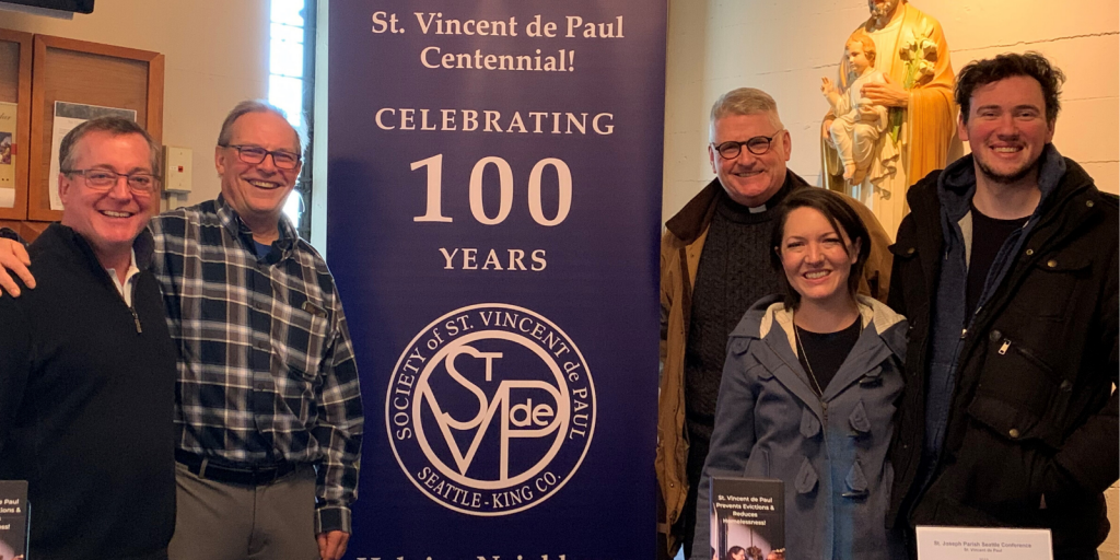 St. Joseph Seattle Vincentians at a Centennial Celebration with Father John Whitney in the background.